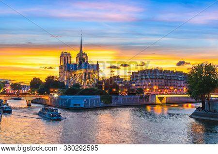 Notre Dame De Paris Cathedral And Seine River