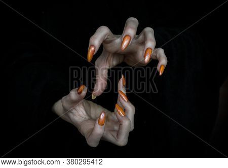 Witch Hands With Sharp Nails And Long Pale Fingers In The Dark, Low Key, Selected Focus.