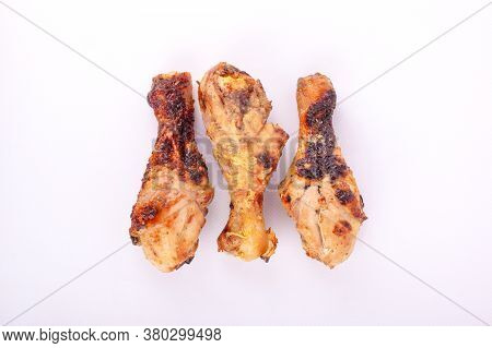 Three Chicken Legs Fired Crust Isolate Close-up. Barbecue Chicken, Picnic, Outdoor Cooked Food.