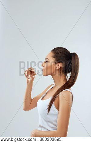 Beautiful Woman Holding  Glass Of Water. Drink Water. Diet Conceptwoman Holding Water Glass. Drink W