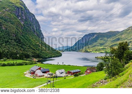 Mountain Panorama With Typical Norwegian Wooden Farmhouse In Forde In Sogn Og Fjorden County In Norw
