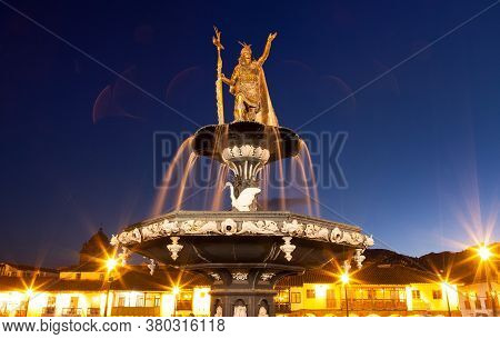 Statue Of Inca Pachacutec On Fountain And Catholic Church On Plaza De Armas, Evening View, Cusco Or