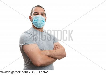 Confident Adult Man Wearing Disposable Protection Mask Holding Arms Crossed With Blank Copyspace Are