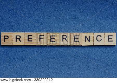 Gray Word Preference In Small Square Wooden Letters With Black Font On A Blue Background