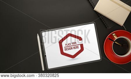 Workplace With Mock Up Digital Tablet, Coffee Cup, Diary Books And Copy Space On Black Table