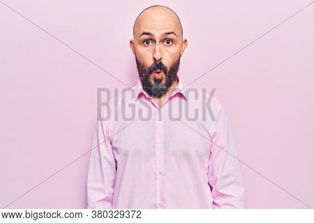 Young handsome man wearing business clothes scared and amazed with open mouth for surprise, disbelief face