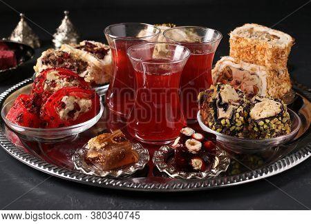Turkish Delight And Pomegranate Tea On Metal Tray On Dark Background, Closeup