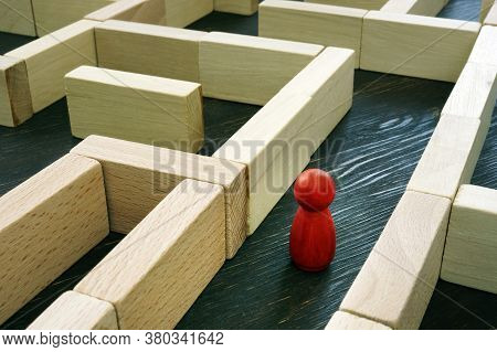 Red Figurine Inside The Maze. Business Challenge And Finding A Solution To The Situation.