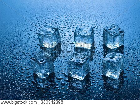 Ice Cubes With Water Drops On Blue Background