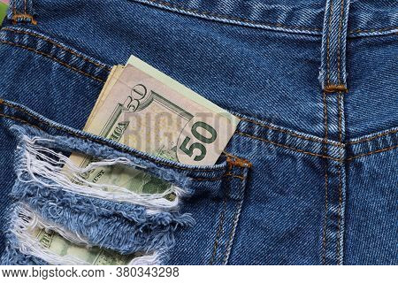 Banknote Money Fifty Us Dollar In The Back Pocket Of Blue Jeans. Concept Of Saving Money Or Finance.