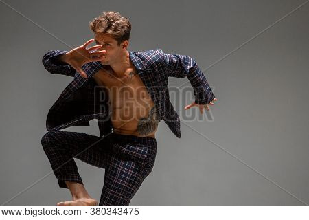 Cool Young Guy Dancer In Suit Dancing Modern Expressive Dance In Studio. Dance School Poster. Dance