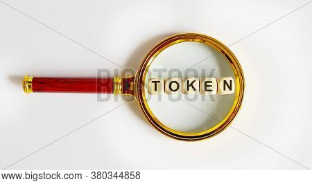 Wooden Token With The Text: Funds On Magnifying Glass.