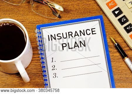 Insurance Plan-lettering Text In Notepad On The Background Of Office Stationery. Ensuring Financial
