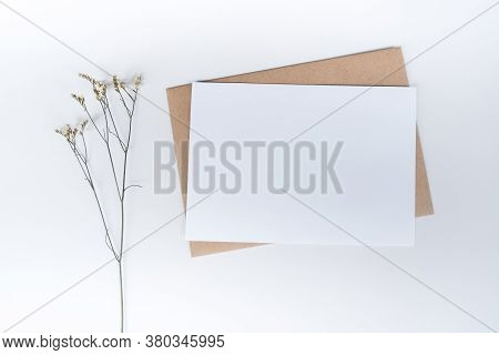 Blank White Paper On Brown Paper Envelope With Limonium Dry Flower. Mock-up Of Horizontal Blank Gree