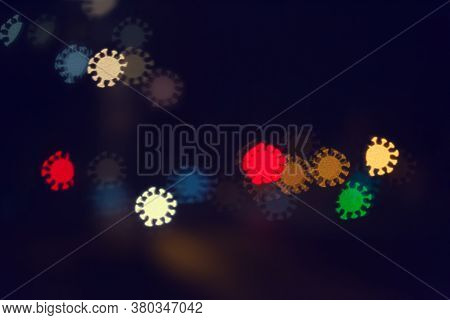 City Lights And Cars In The Form Of A Bokeh In The Form Of A Coronavirus, The Concept Of The Spread