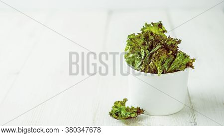 Kale Chips With Salt In White Paper Cup. Homemade Healthy Snack For Low Carb, Keto, Low Calorie Diet