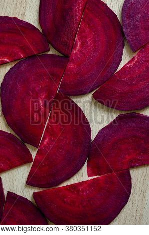 Geometric Pattern Of Raw Beet Slices. Abstract Geometric Background From Red Beets. View At An Angle