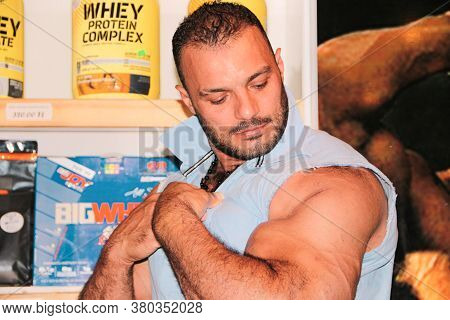 Aleppo, Syria December 09, 2019:\na Bodybuilder Flexing His Huge Muscles