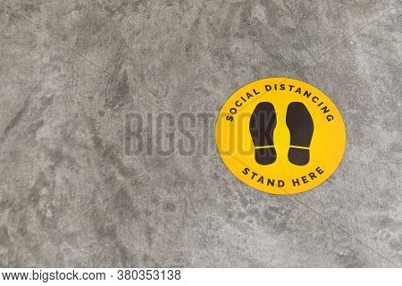 Footprint Sign For Stand In Shopping Mall, Supermarket. Social Distancing , Covid-19 Comcept. Ccoron