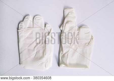 Pair Of Medical White Latex Protective Gloves On White Background. Protective Disposable Gloves Agai