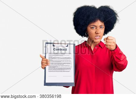 Young african american girl holding clipboard with contract document annoyed and frustrated shouting with anger, yelling crazy with anger and hand raised