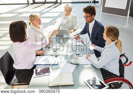 Group of business people at conference table in meeting during project planning