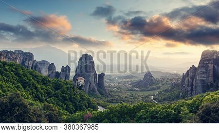 Wonderful Panoramic View Of Meteora. Majestic Sunny Landscape With Colorful Sky Over The Fairytale M