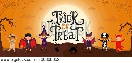 Trick Or Treat Scary Text With Kids In Halloween Costume On Spooky Night Landscape Under Moonlight.