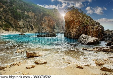 Scenic Greece Landscape. Seascape Of Ionian Sea. Greece. Gyali Beach With Colorful Sky During Sunset