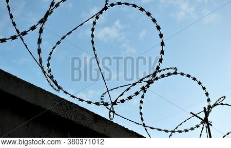 Protective Barbed Wire With Sharp Teeth On The Fence