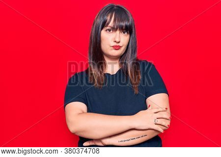 Young plus size woman wearing casual clothes skeptic and nervous, disapproving expression on face with crossed arms. negative person.