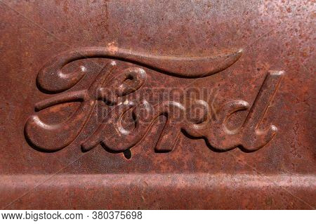 Barnesville, Minnesota Juky 21, 2020: The Rusty Ford Tractor Hood Logo Is A Product Of The Ford Moto