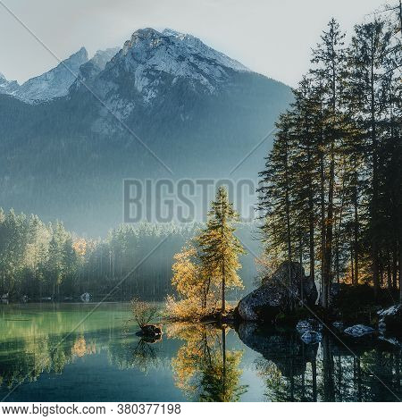 Wonderful Autumn. Sunny Misty Morning At Hintersee Lake In Bavaria, Germany. Amazing Sunset On The M