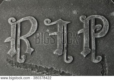 Closeup Of A Gravestone With The Words Rip Rest In Peace.