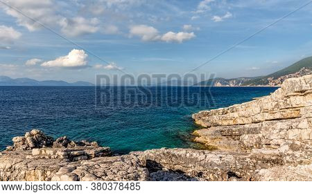Natural Seascape In The Greece. Seascape With Rocky Beach, Turquoise Water And Colorful Sky. Amazing