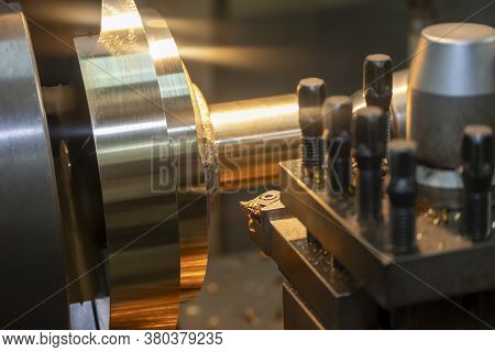 The Operation Of Lathe Machine Cutting The Brass Shaft Parts With The Cutting Tools. The Metalworkin