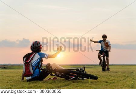 Woman Riding Mountain Bike Was Accident Crashed And Fell To The Grass While A Lover Her Coming In To