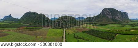 Aerial View Drone Panorama. Mountain And Corn Field In Rainy Season. Agriculture And Beautiful Natur