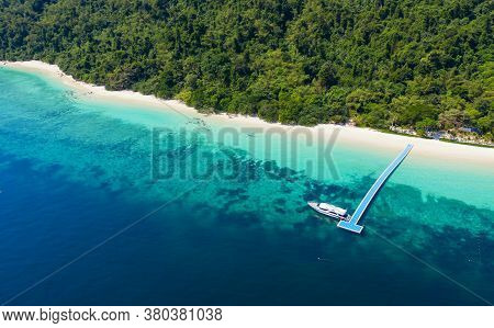 Aerial View Ocean Waves, Beach And Rocky Coastline And Beautiful Forest. Nyaung Oo Phee Island Myanm