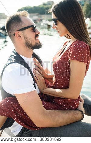 Love Story Outdoors In Summer. An Attractive Young Couple In Love In A Hug. Closeup Portrait Of A Gi