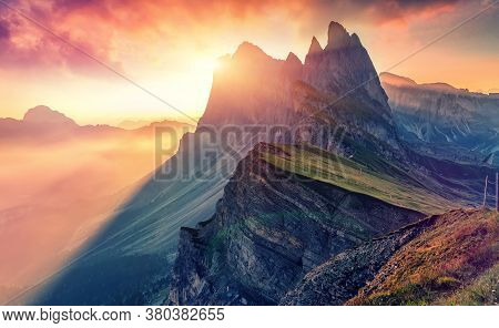 Colorful Evening Scene At Gardena Valley During Sunset. Bright Sky Over The Seceda Peak Glowing Sunl