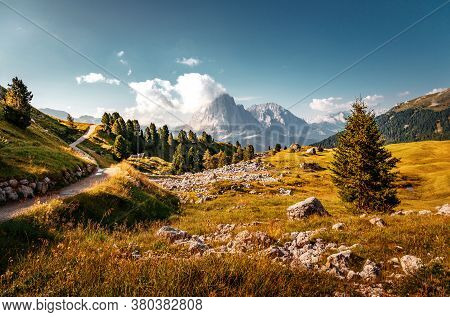 Beautiful Alpine Countryside. Awesome Alpine Landscape With Traditional Huts. Amazing Nature Scenery
