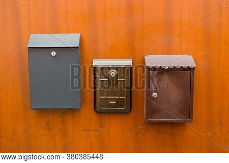Old Letterboxes On The Brown Door, Vintage Post Box Or Letterbox. Correspondence