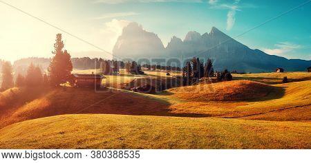 Stunning Morning Scene. Majestic Moutain Peak Sassolungo Under Sunlight, Alpe Di Siusi Valley During