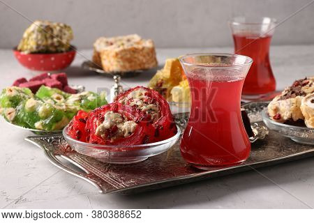 Turkish Delight And Pomegranate Tea On Metal Tray On Gray Background, Closeup, Horizontal Format