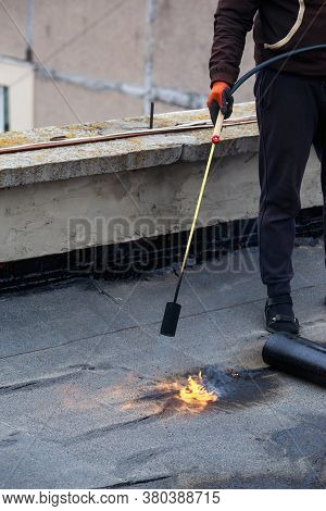 Roll Of Roofing Material With A Gas Burner