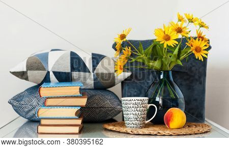 Cozy Home Interior Decor: Stack Of Books, Peach, Cup Of Coffe, Decorative Pillows, Box With Plaid An