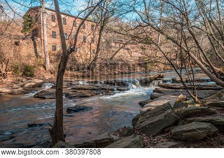 Big Creek Flowing With Small Waterfalls Downstream Alongside The Old Mill Park In Roswell Georgia On