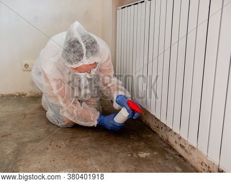 Removing Mold From Internal Walls. Elimination Of Mold At Home Under The Heating Battery.