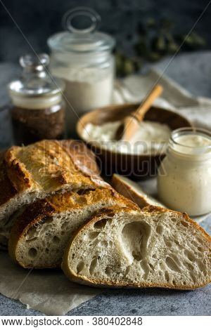 Artisan Sourdough Bread Cut Into Slices On A Dark Background Close-up, Vertical Background